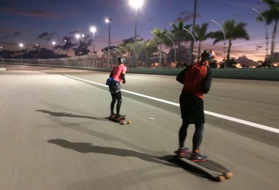 Two skateboarders at sunset